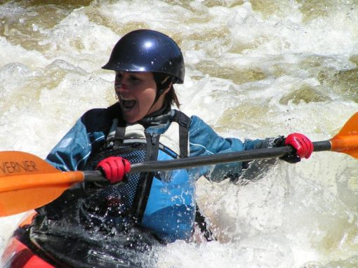 whitewater kayak with paddle that's shorter