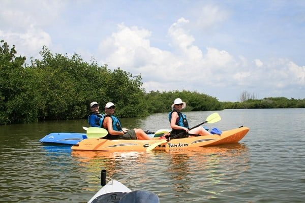 two adults sit on top kayak