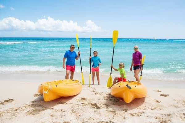 Happy family with kayaks